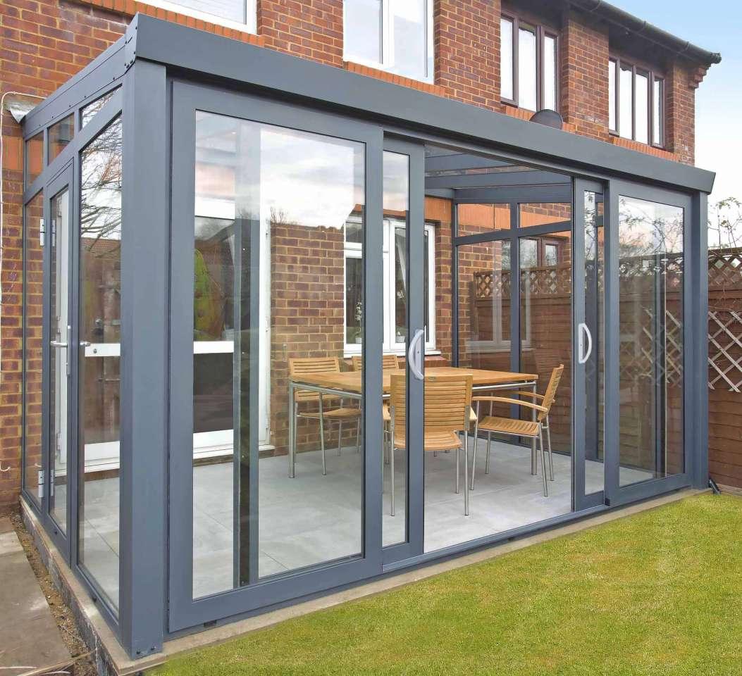Gartenzimmer mit Schiebetür und Glas Dacheindeckung ...